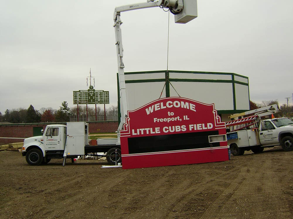 Little Cubs Field Sign being hung.